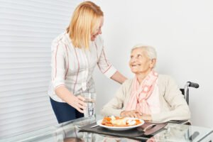 bigstock Nursing lady serves old woman 247971127