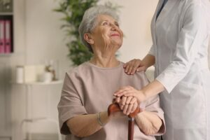 bigstock Elderly woman holding hands on 174130534